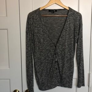 Charcoal gray and white striped cardigan sweater.